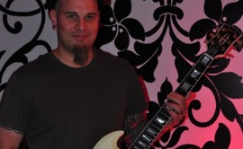 Tim Izo Orindgreff of the Black Eyed Peas with his EverTune SG Guitar